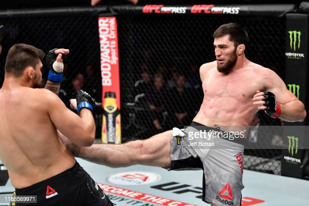 Shamil Gamzatov of Russia kicks Klidson Abreu of Brazil in their light heavyweight bout during the UFC Fight Night event at CSKA Arena on November 09...