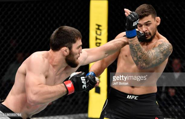 Shamil Gamzatov of Russia punches Klidson Abreu of Brazil in their light heavyweight bout during the UFC Fight Night event at CSKA Arena on November...