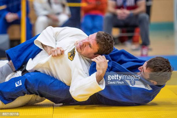 Shamil Magomedov of Russia here attempting to strangle his opponent into submission defeated Sebastian Junk of Germany by a wazari as he progressed...