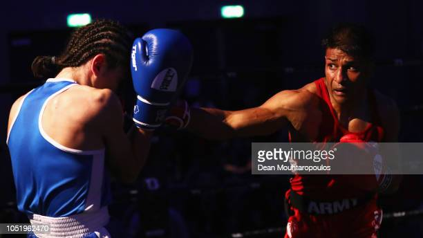 Shamim Khan of the British Army Boxing team and England lands a punch on Bastien Martinez of the Angel Boxing Team Garages and France during the...