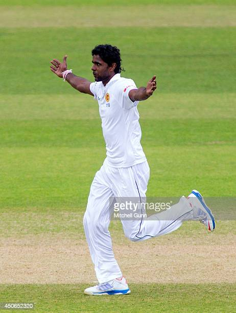 Shaminda Eranga of Sri Lanka celebrates taking the wicket of Ian Bell of England during the Investec 1st Test Match day four between England and Sri...