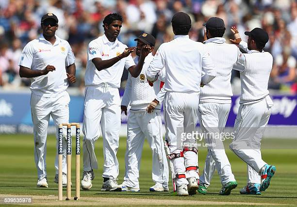 Shaminda Eranga of Sri Lanka is congratulated on bowling Steven Finn of England for LBW during day four of the 3rd Investec Test match between...
