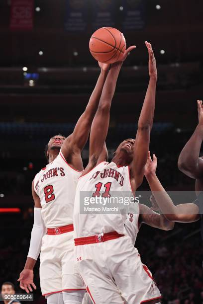 Shamorie Ponds and Tariq Owens of the St John's Red Storm get a rebound during the NCAA men's basketball game against the Villanova Wildcats at...