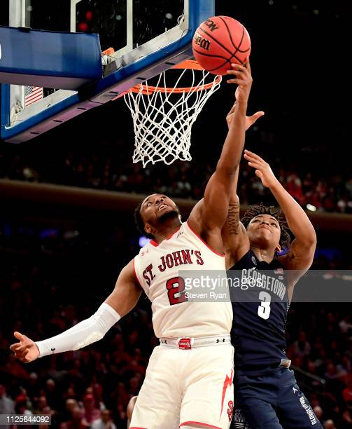 Shamorie Ponds of the St John's Red Storm and James Akinjo of the Georgetown Hoyas battle for the rebound at Madison Square Garden on January 27 2019...