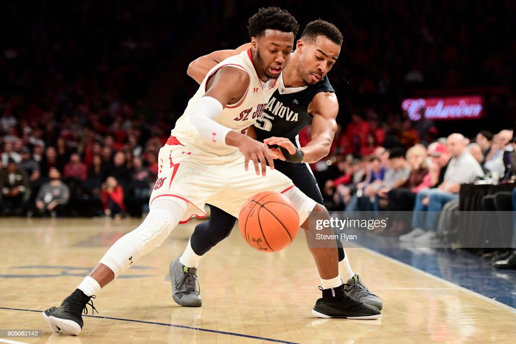Shamorie Ponds #2 of the St. John's Red Storm and Phil Booth #5 of the Villanova Wildcats battle for the ball during an NCAA men's basketball game at Madison Square Garden on January 13, 2018 in New York City.