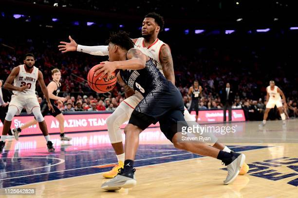Shamorie Ponds of the St John's Red Storm defends James Akinjo of the Georgetown Hoyas at Madison Square Garden on January 27 2019 in New York City