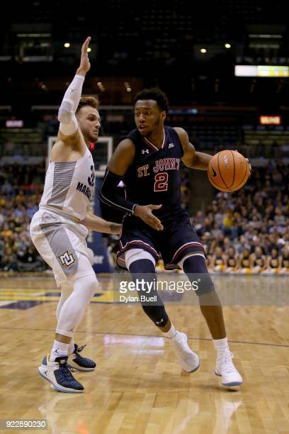 Shamorie Ponds of the St John's Red Storm dribbles the ball while being guarded by Andrew Rowsey of the Marquette Golden Eagles in the second half at...