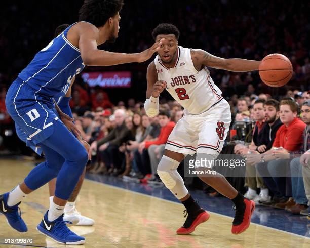 Shamorie Ponds of the St John's Red Storm drives against Marvin Bagley III of the Duke Blue Devils at Madison Square Garden on February 3 2018 in New...