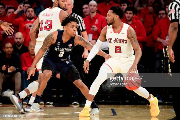 Shamorie Ponds of the St John's Red Storm is defended by James Akinjo of the Georgetown Hoyas at Madison Square Garden on January 27 2019 in New York...