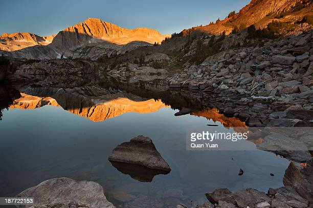 Shamrock Lake, Twenty Lakes Basin, California. First light in the morning lit up North Peak and there was beautiful reflection on the lake.