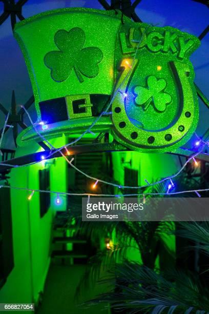 Shamrocks, symbol of Ireland over the entrance to the Irish Pub seen during Saint Patricks Day celebration on March 17, 2017 in Warsaw, Poland. Saint...