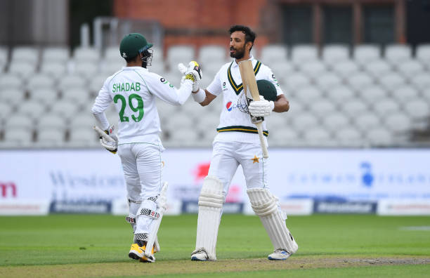 Celebrates with Shadab Khan after reaching his century during Day Two of the 1st #RaiseTheBat Test Match between England and...