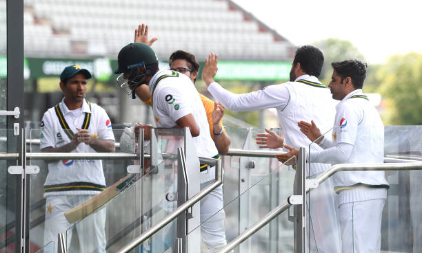 Shan Masood of Pakistan is congratulated by his teammates after being dismissed during Day Two of the 1st #RaiseTheBat Test Match between England and...