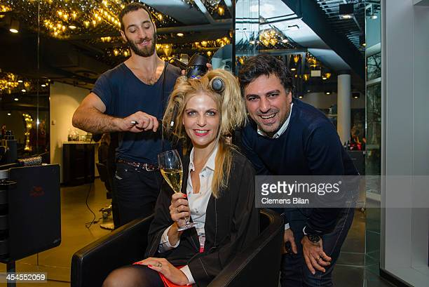 Shan Rahimkhan and Tanja Buelter pose during a styling session at Salon Shan Rahimkhan on December 9 2013 in Berlin Germany