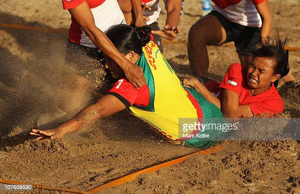 Shanaj Maleka of Bangladesh dives for the line as she competes in the Beach Kabaddi event at North Al Hail during day eight of the 2nd Asian Beach...