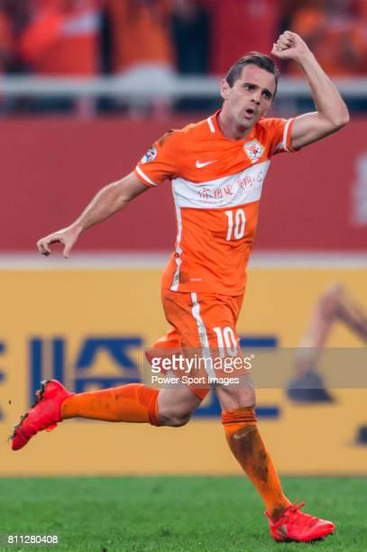 Shandong Luneng FC midfielder Walter Montillo celebrates after scoring his goal during the AFC Champions League 2016 Quarter Final 2nd leg between...