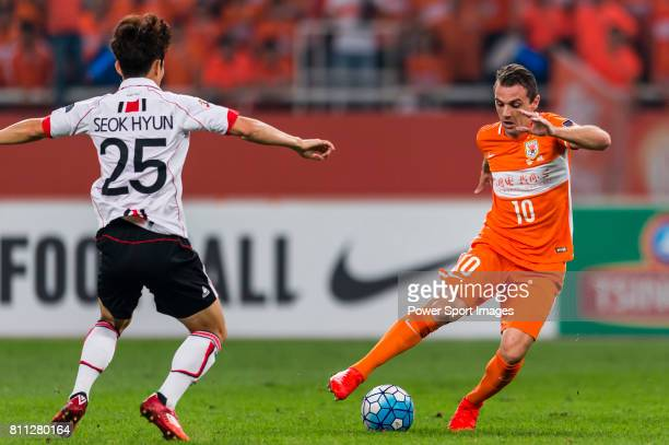 Shandong Luneng FC midfielder Walter Montillo dribbles against FC Seoul midfielder Lee Seokhyun during the AFC Champions League 2016 Quarter Final...