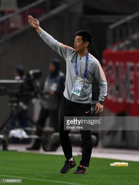 Shandong Luneng head coach Li Xiaopeng gesture during the AFC Champions League Group E match between Kashima Antlers and Shandong Luneng at Kashima...