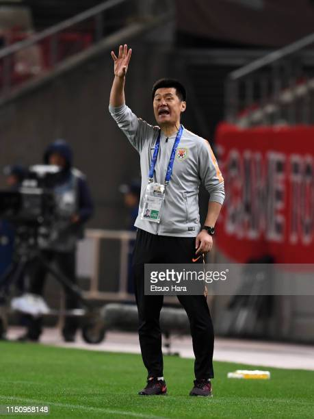 Shandong Luneng head coach Li Xiaopeng gestures during the AFC Champions League Group E match between Kashima Antlers and Shandong Luneng at Kashima...