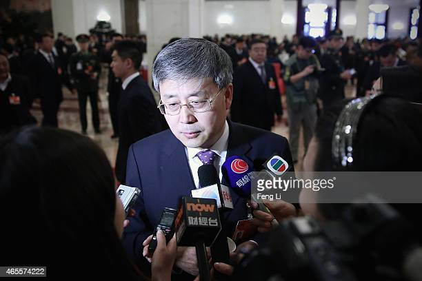 Shandong province Governor Guo Shuqing answers media questions before the second plenary session of China's parliament the National People's Congress...