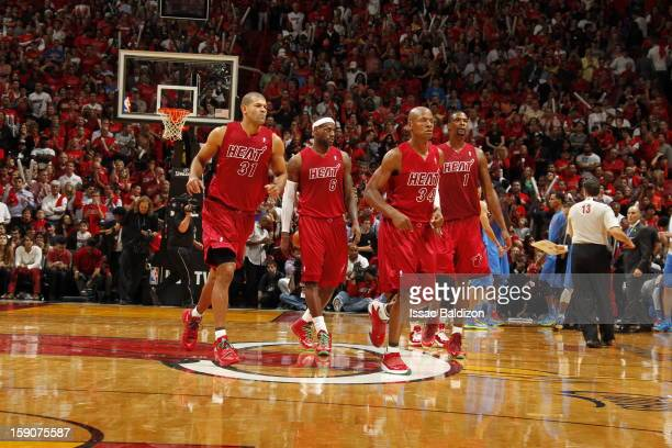 Shane Battier LeBron James Ray Allen and Chris Bosh of the Miami Heat walk off the court in the game against the Oklahoma City Thunder on December 25...