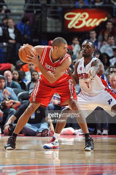 Shane Battier of the Houston Rockets handles the ball against Ben Gordon of the Detroit Pistons during the game on March 7 2010 at The Palace of...