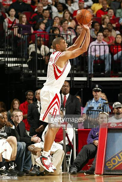 Shane Battier of the Houston Rockets shoots a jump shot during the game against the San Antonio Spurs at Toyota Center on November 29 2008 in Houston...