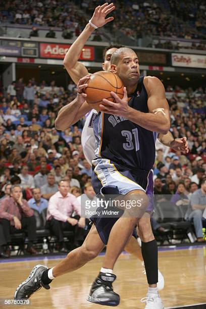 Shane Battier of the Memphis Grizzlies drives to the basket around Kevin Martin of the Sacramento Kings on February 7 2006 at the ARCO Arena in...