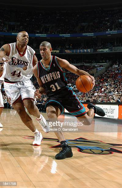 Shane Battier of the Memphis Grizzlies drives to the basket past Derrick Coleman of the Philadelphia 76ers during the NBA game at first Union Center...