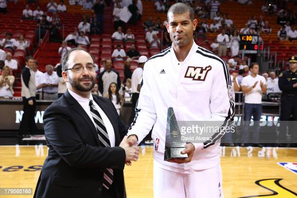 Shane Battier of the Miami Heat accepts the 20122013 Magic Johnson Award before playing the Chicago Bulls in Game Two of the Eastern Conference...