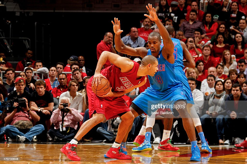 Shane Battier #31 of the Miami Heat controls the ball against Serge Ibaka #9 of the Oklahoma City Thunder during a Christmas Day game on December 25, 2012 at American Airlines Arena in Miami, Florida.
