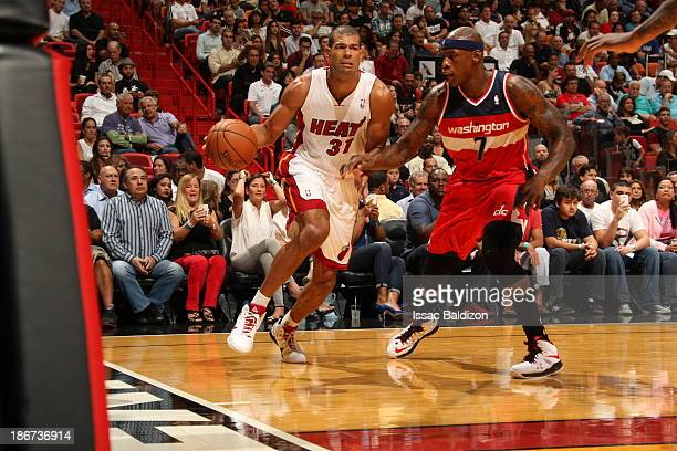 Shane Battier of the Miami Heat drives against Al Harrington of the Washington Wizards on November 3 2013 at American Airlines Arena in Miami Florida...