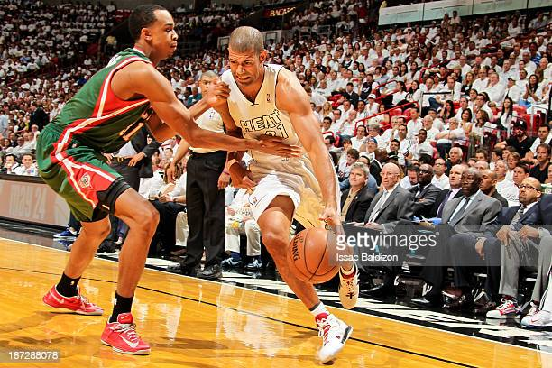 Shane Battier of the Miami Heat drives against John Henson of the Milwaukee Bucks in Game Two of the Eastern Conference Quarterfinals during the 2013...