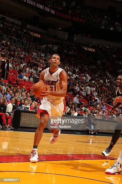 Shane Battier of the Miami Heat drives to the basket against the Brooklyn Nets during a game on October 25 2013 at American Airlines Arena in Miami...