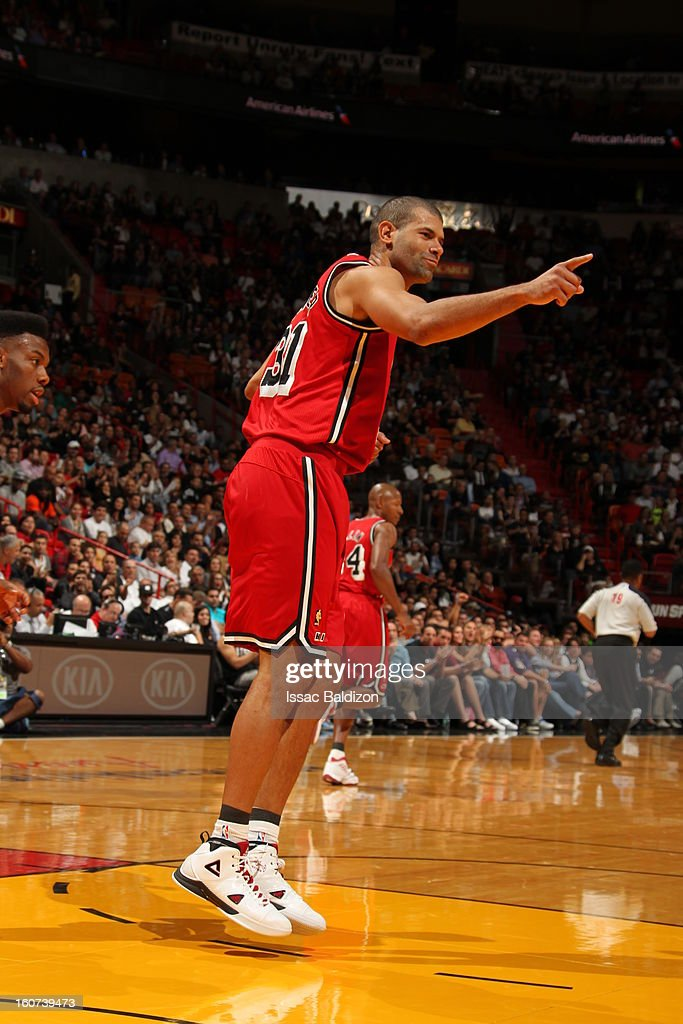 Shane Battier #31 of the Miami Heat points to his bench in excitement against the Charlotte Bobcats during a game on February 4, 2013 at American Airlines Arena in Miami, Florida.