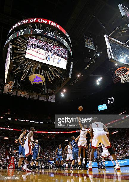 Shane Battier of the Miami Heat wins a jump ball over Jose Juan Barea of the Minnesota Timberwolves during a game at American Airlines Arena on...
