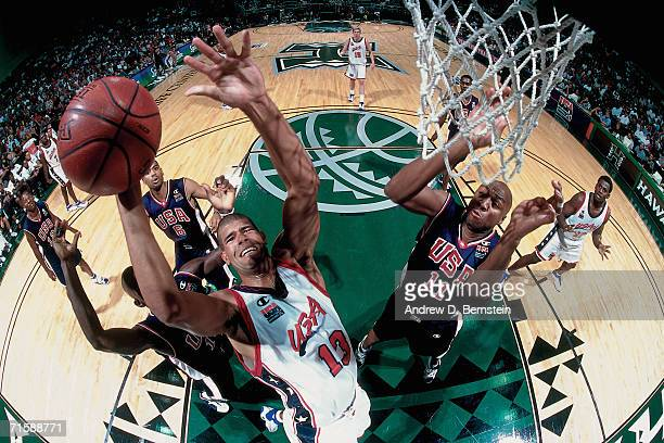 Shane Battier of the United States Select Team attempts a layup against the Vin Baker of the United States National Team during a pre-Olympic...
