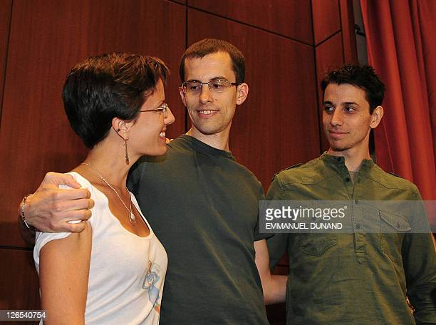 Shane Bauer and Josh Fattal, two US hikers held by Iran for more than two years on spying charges, hug with fellow former detainee Sarah Shroud...