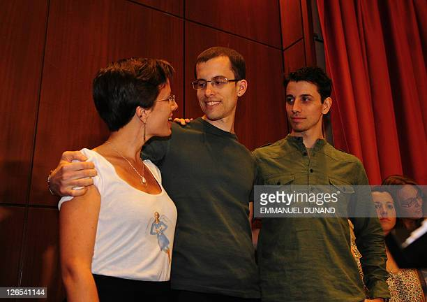 Shane Bauer and Josh Fattal two US hikers held by Iran for more than two years on spying charges hug with fellow former detainee Sarah Shroud during...