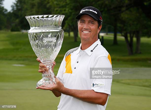 Shane Bertsch poses with the winners trophy after winning the Webcom Tour RustOleum Championship at the Lakewood Country Club on June 14 2015 in...