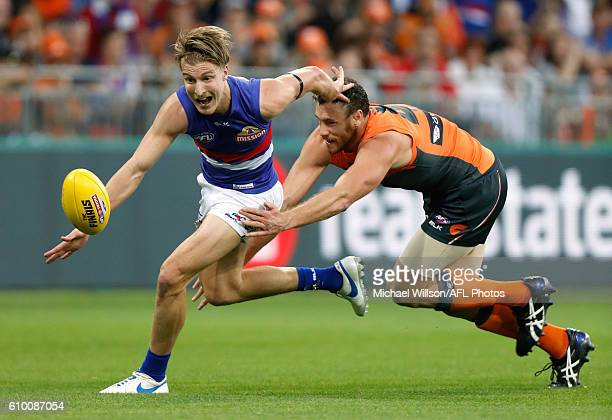 Shane Biggs of the Bulldogs and Shane Mumford of the Giants compete for the ball during the 2016 AFL First Preliminary Final match between the GWS...