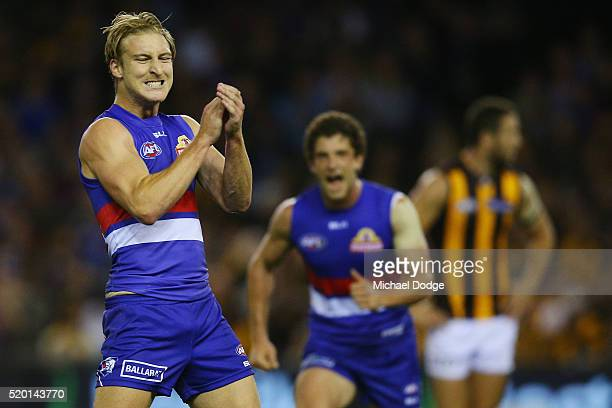 Shane Biggs of the Bulldogs celebrates a goal with Tom Liberatore of the Bulldogs during the round three AFL match between the Western Bulldogs and...