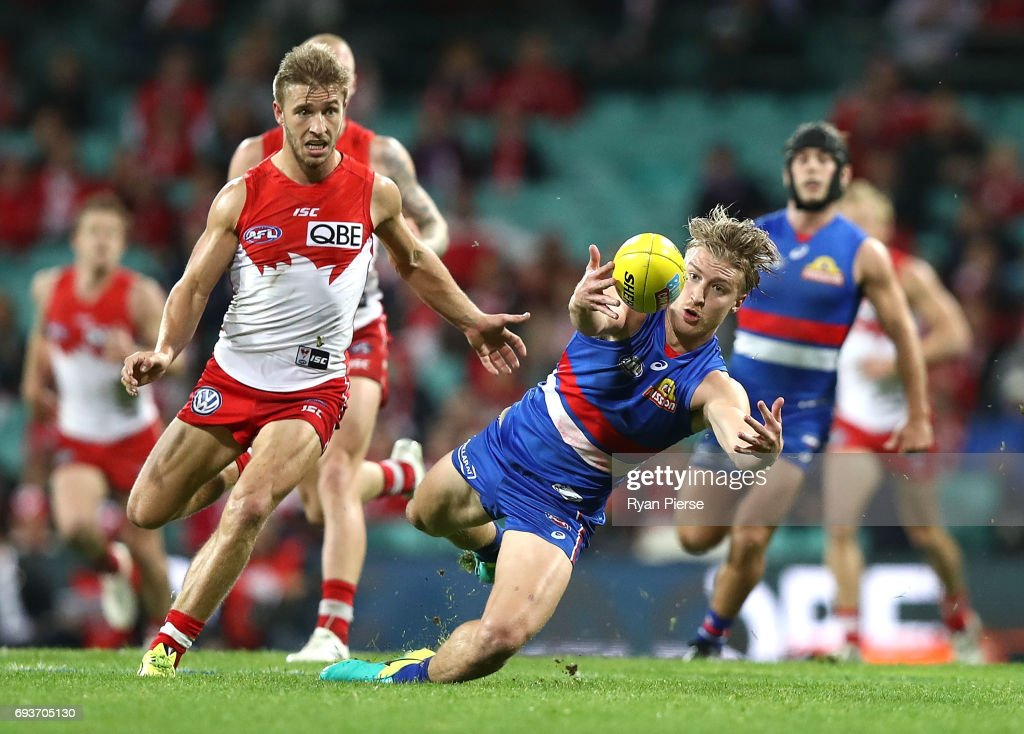 Shane Biggs of the Bulldogs marks in front of Kieren Jack of the Swans during the round 12 AFL match between the Sydney Swans and the Western Bulldogs at Sydney Cricket Ground on June 8, 2017 in Sydney, Australia.