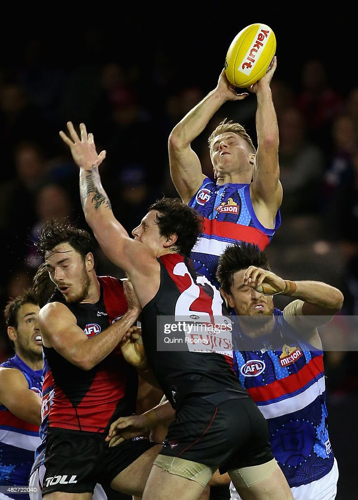 Shane Biggs of the Bulldogs marks over the top of Jake Carlisle of the Bombers during the round 18 AFL match between the Essendon Bombers and the Western Bulldogs at Etihad Stadium on August 2, 2015 in Melbourne, Australia.
