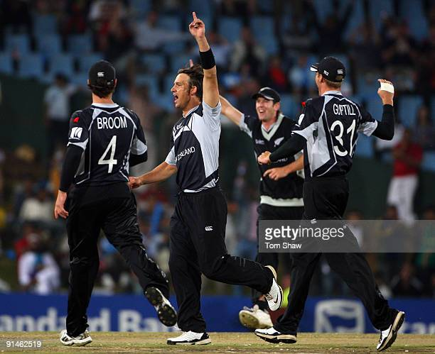 Shane Bond of New Zealand celebrates taking the wicket of Tim Paine of Australia during the ICC Champions Trophy Final between Australia and New...