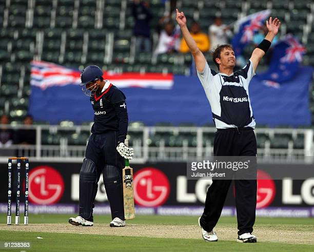 Shane Bond of New Zealand celebrates the wicket of Ravi Bopara during The ICC Champions Trophy Group B Match between England and New Zealand at...