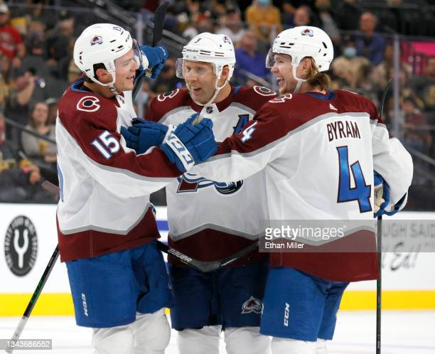 Shane Bowers, Jack Johnson and #Bowen Byram 4 of the Colorado Avalanche celebrate Johnson's third-period goal against the Vegas Golden Knights during...