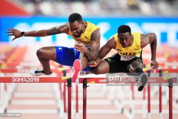 Shane Brathwaite of Barbados collides with Ronald Levy of Jamaica in the Men's 110 metres hurdles semi finals during day six of 17th IAAF World...