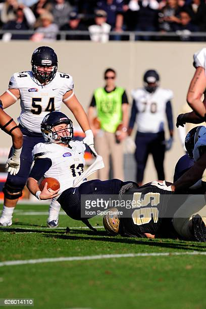 Shane Bucenell quarterback Charleston Southern University Buccaneers is sacked by Steven Cornellier defensive lineman Wofford College Terriers in the...