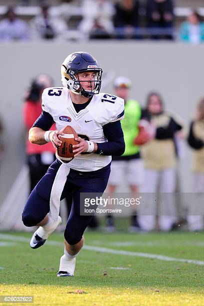Shane Bucenell quarterback Charleston Southern University Buccaneers scrambles with the football against the Wofford College Terriers during the...